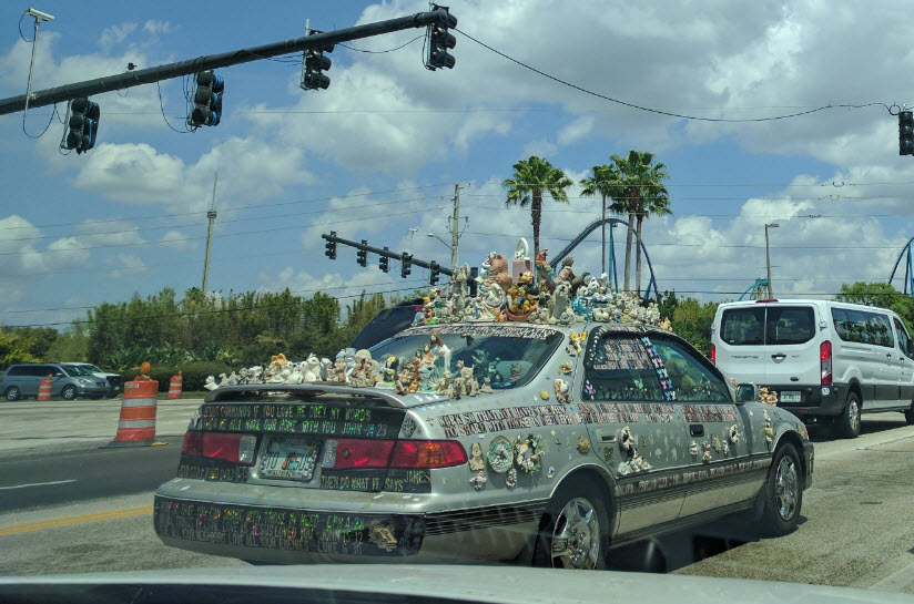 car with a bunch of disney stuffed animals attached to it