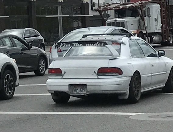 white car with sticker that says DM the nudes