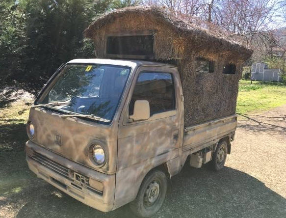 hunting shed built into the back of a small truck