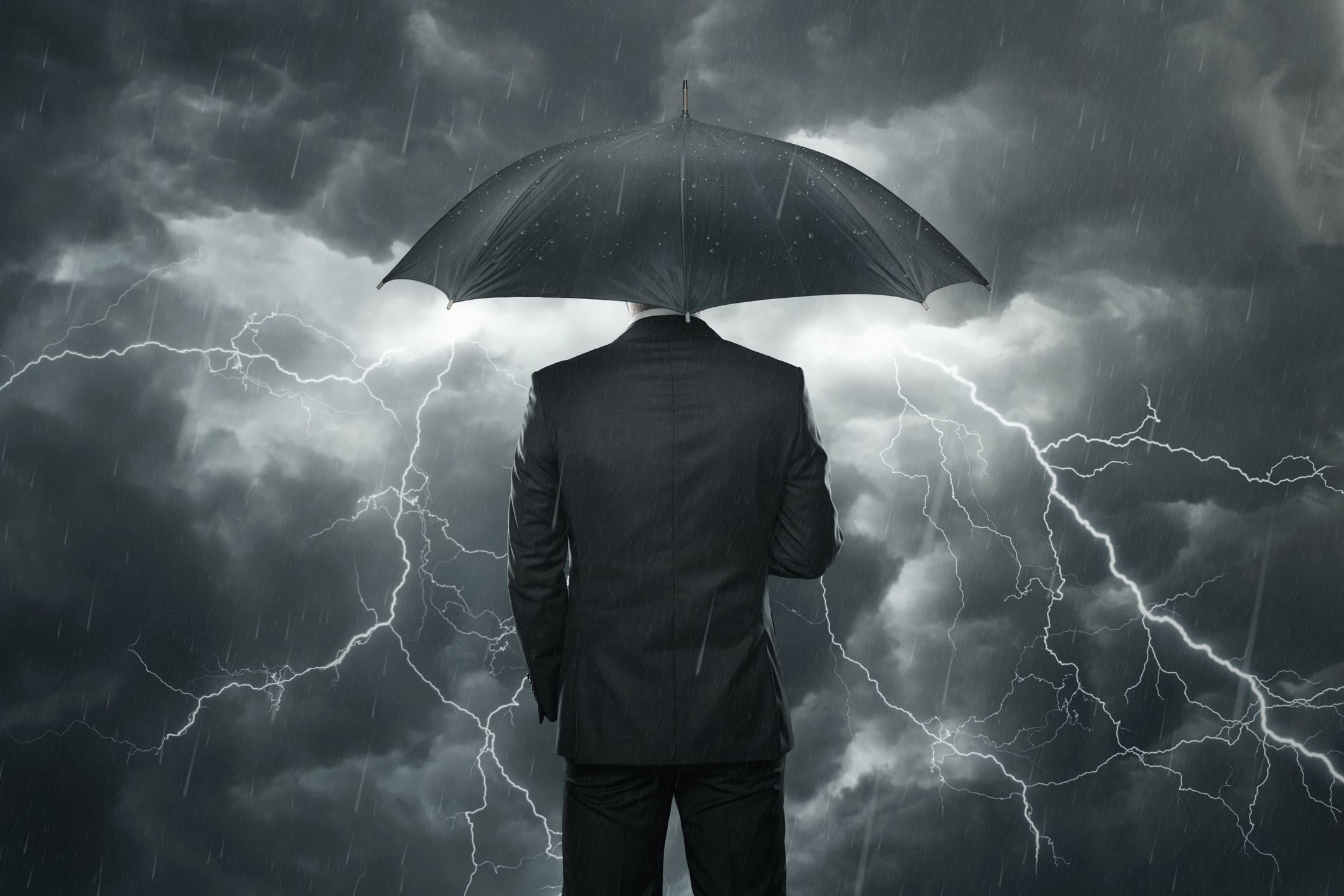 man standing in a thunder storm